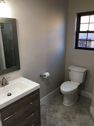 Bathroom with high end finishes.  Complimentary body wash, shampoo and conditioner.