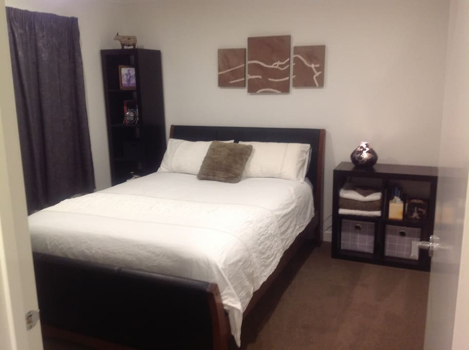 Comfy queen sized bed with quality linen. I have two rooms available so check out Close to the Airport # 2 if your dates are not available.