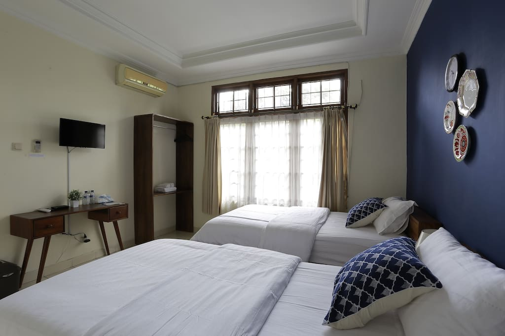 Our Blue twin bed room has a unique ambience to satisfy your needs to unwind.