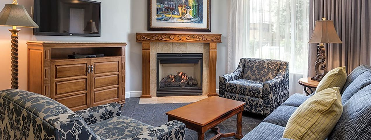 Condo Living room with fireplace