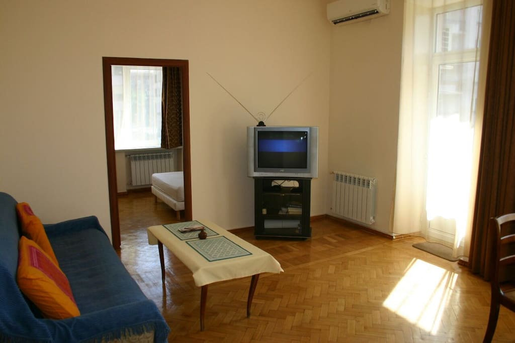 Living room with TV and little balcony