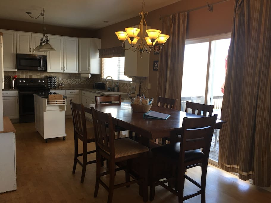 The dining room is located between the kitchen and the living room.  Sliding glass doors lead to the spacious double deck.
