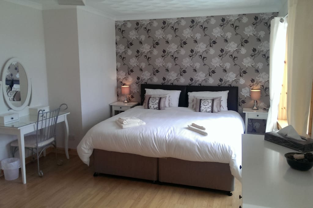 Front bedroom with ensuite facilities. can have either a super kingsize bed or two single beds