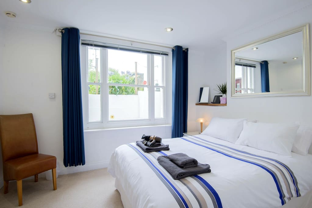 The master suite. King-sized double bed, and window to private rear courtyard.