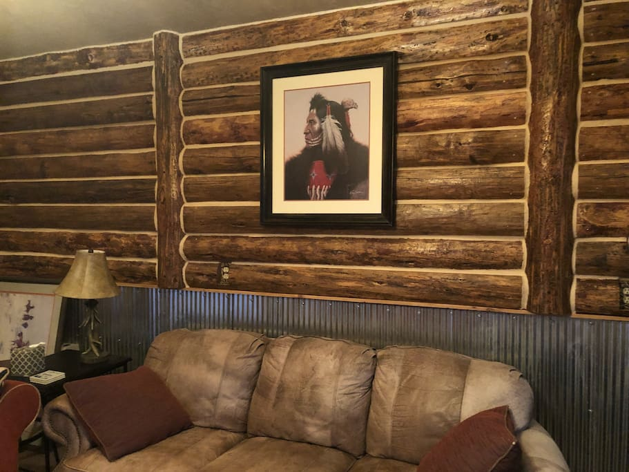 log wall and leather couch