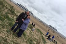 "Alan and Jan on Crosby Beach with 3 Cunard cruise ships "" The Three Queens "" in the background"