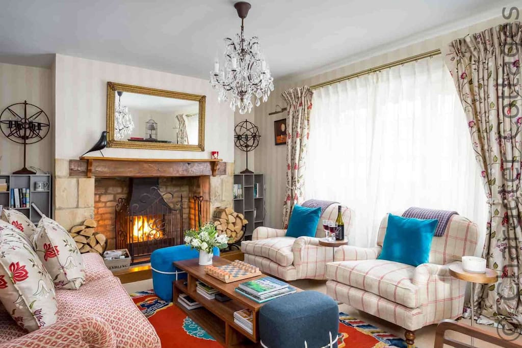 The stylish and comfy living room, with a roaring open fire