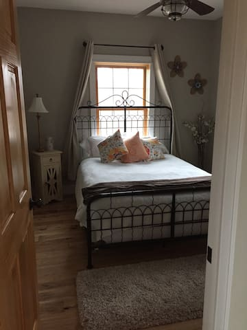 Main floor bedroom queen bed
