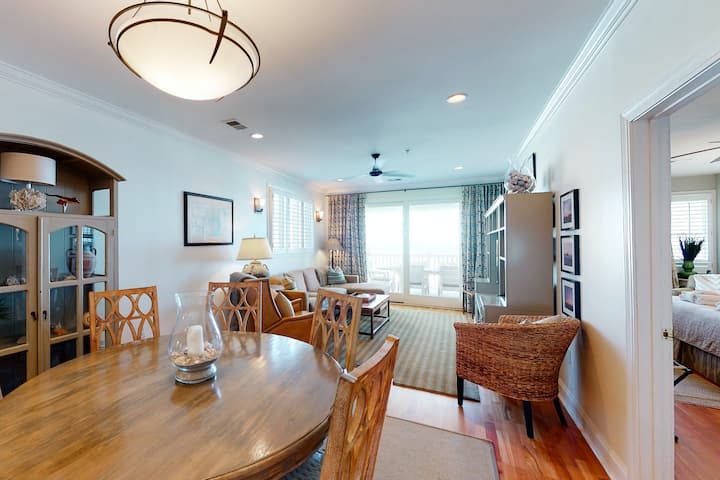 Third-floor condo w/ beach and ocean views, private front porch entrance, & deck
