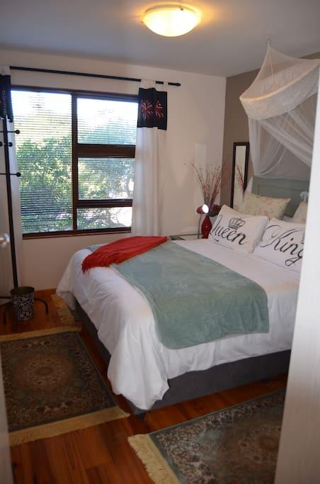 Quantum Lights bedroom with a queen bed