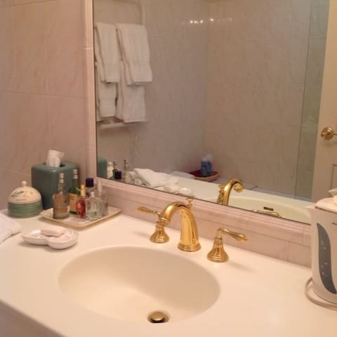 Deluxe bathroom with towel warmer, all amenities, tub with shower. Tea & coffee facilities. Marble tiled floor.
