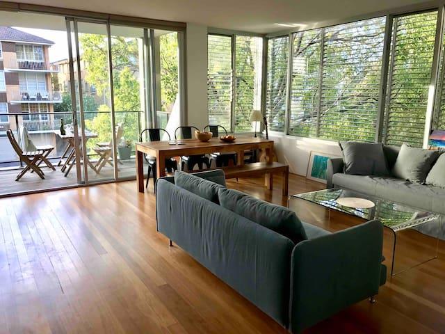 Cosy living room opening on large balcony