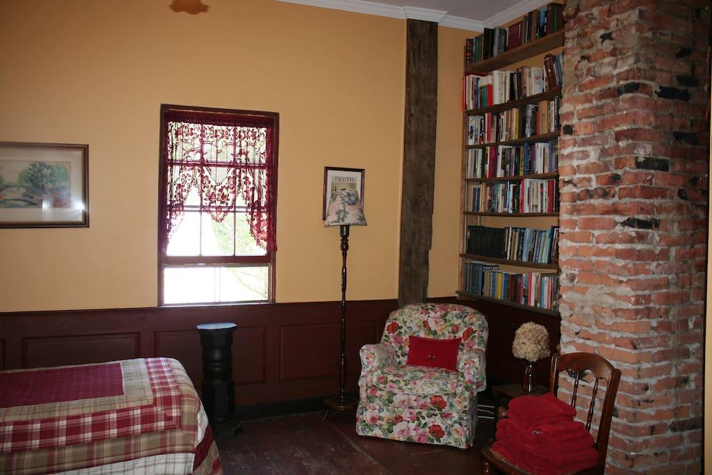 Brick chimney and bookshelves