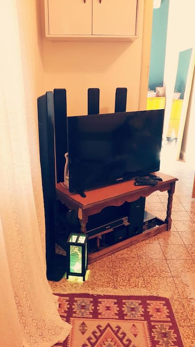 TV set with satellite, DVD player and surround sound system with new DVD releases