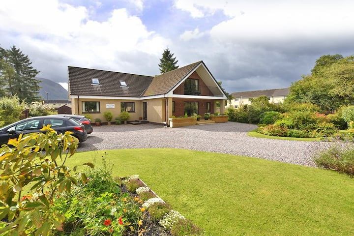 Spacious Family Room with views to Ben Nevis.
