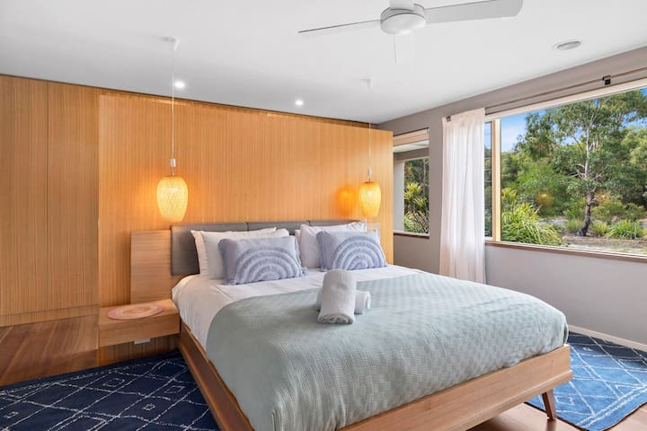 The master has a king-size bed and is zoned for privacy, with a walk-in robe and an ensuite including huge twin shower and large bath.