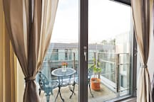 Balcony view with garden furniture overlooking private roof garden
