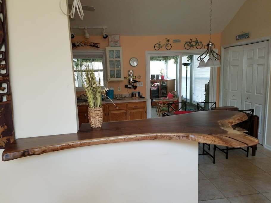 Natural wood bar with 3 stools - great for cocktails or breakfast.