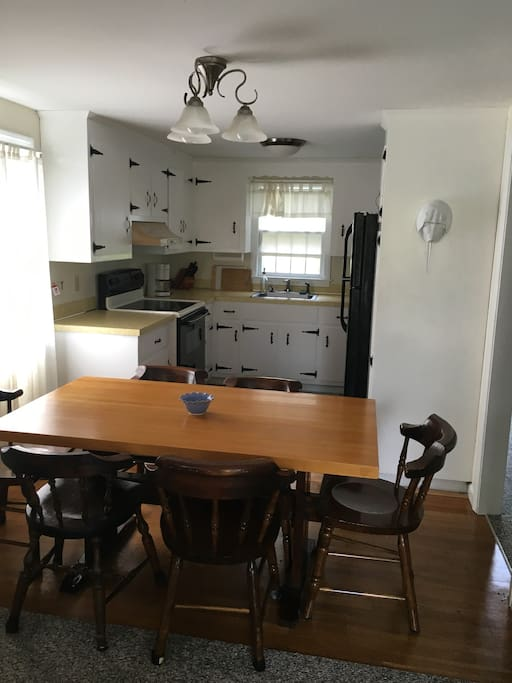 Clean and bright kitchen with a table to seat 6 comfortably