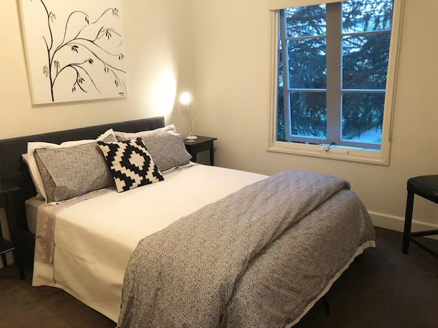 Guest Bedroom with queen-sized bed and designer luxury linens.