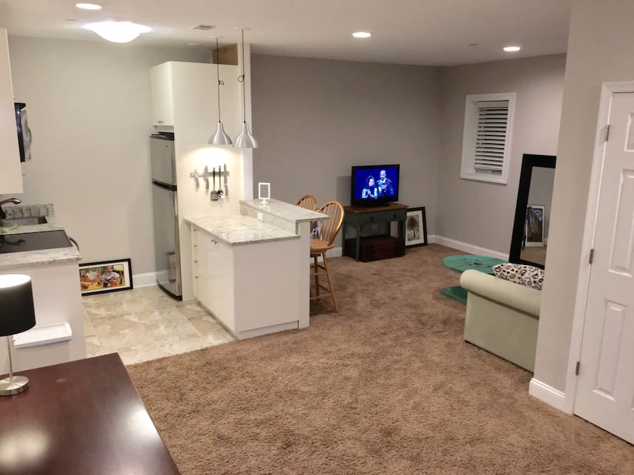 Photo taken from the mud room entryway looking toward the living area.