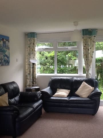 Cosy Living Room with Large Flat Screen TV on Wall, and Free Wifi