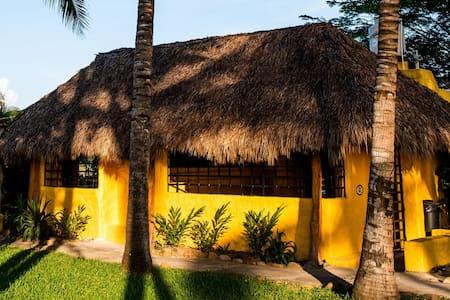 Rustic beachfront house on semi-virgin beach for3★