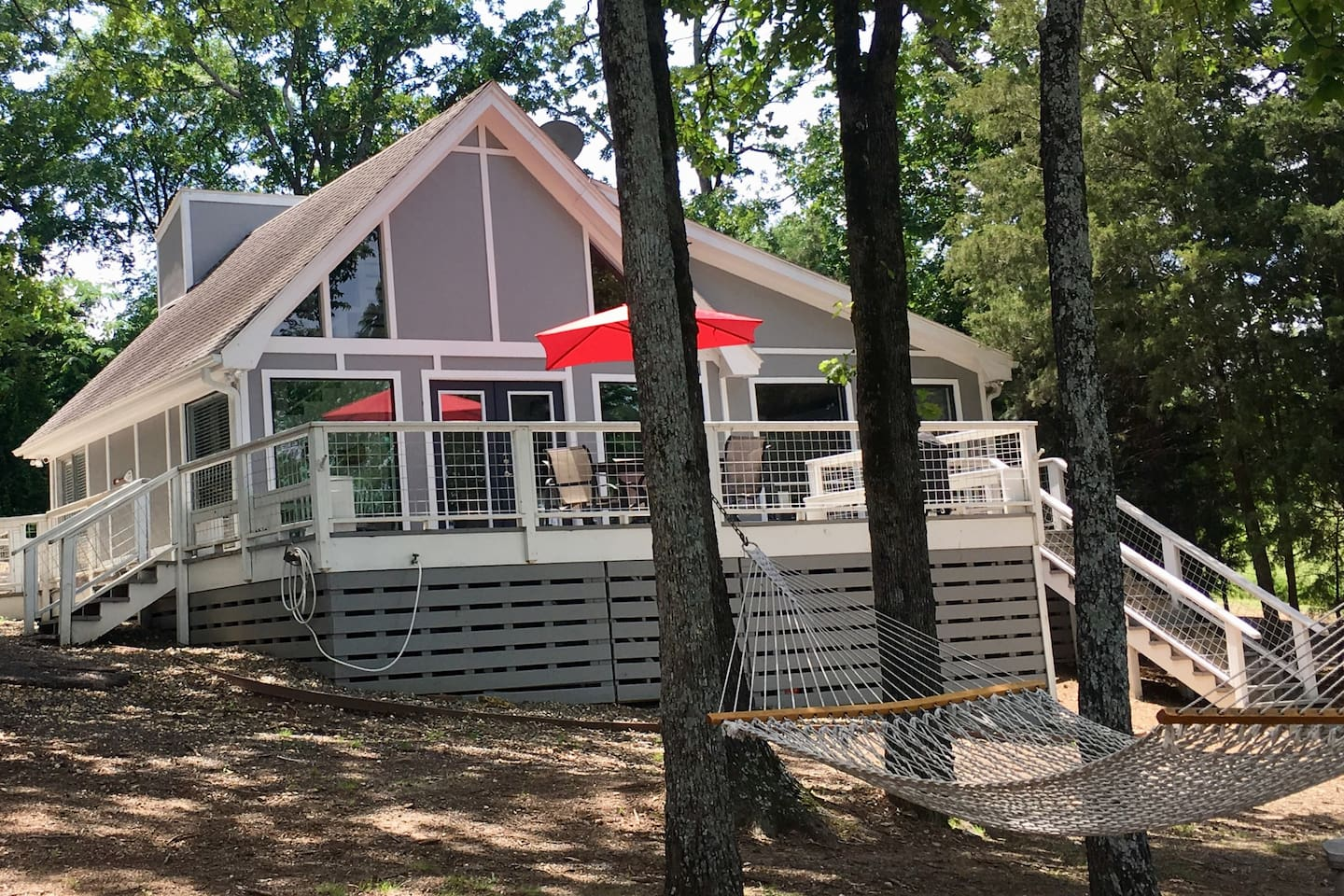 Lakefront living at Camp Canoe! Windows and deck take advantage of the view.