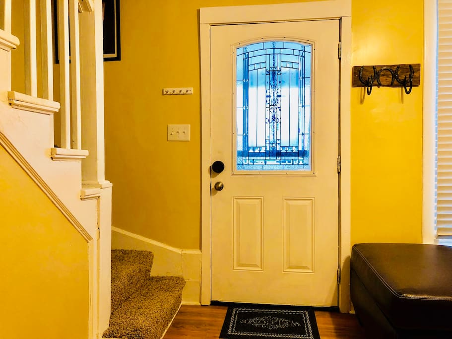 Front door with key holder above light switch.