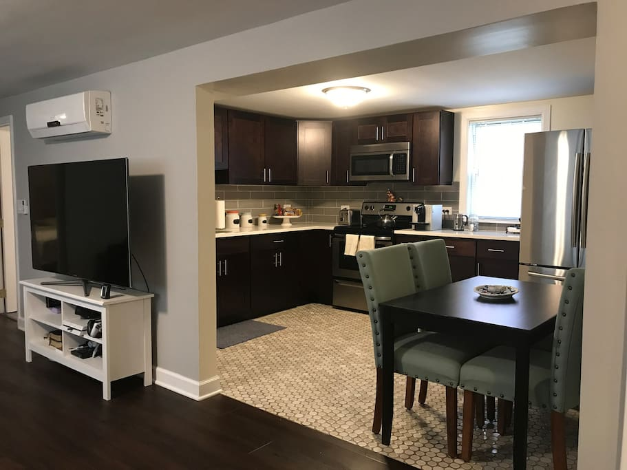 "Kitchen with coffee bar and seating for 4, 60"" smart tv connected to wifi with access to Netflix and other smart apps"