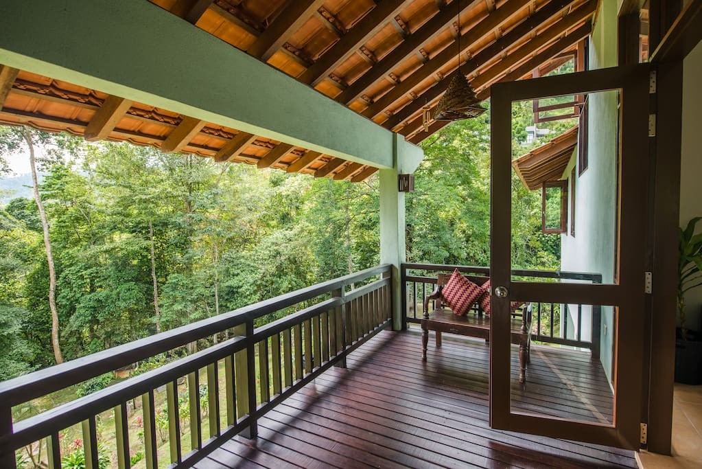 Outdoor wooden verandah with amazing view of the forest.