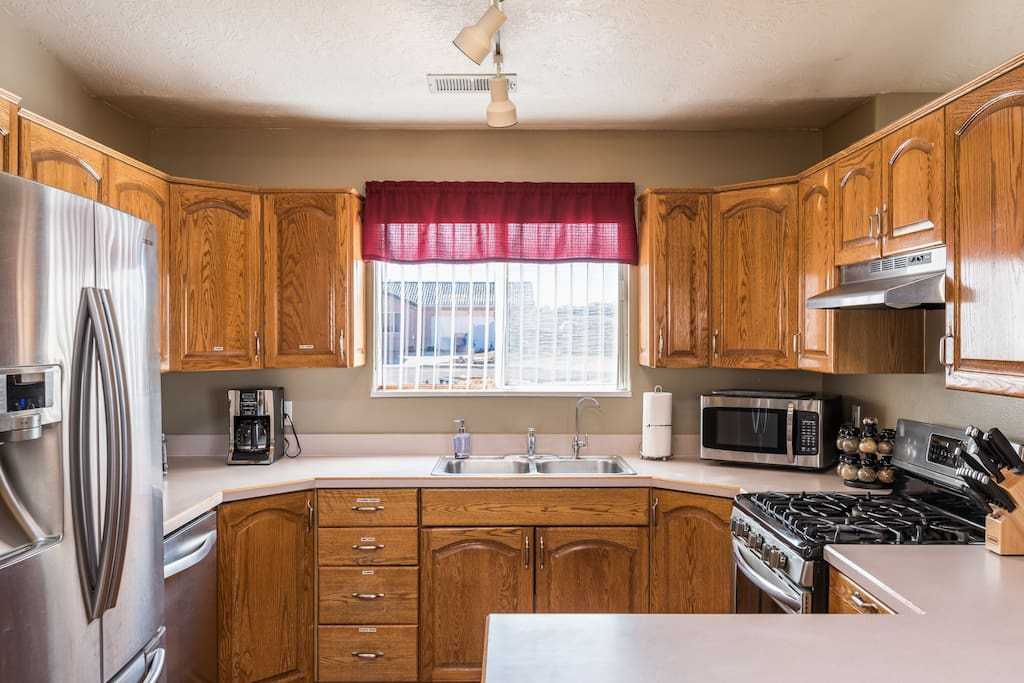 FULLY STOCKED  KITCHEN. Coffee and basic spices. Stainless Steel appliances.