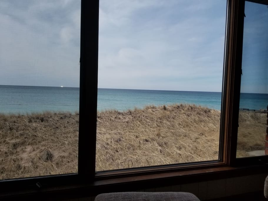 Main Room - Best seat in the world when you are inside. 2 comfy chairs in front of Lake Michigan. We spend hours here drinking coffee or reading a good book.