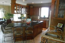Fully equipped kitchen open to living room and dining room