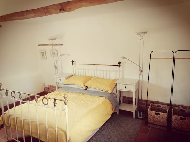 11, Double bedroom in the stables unit with access via the decked area within the parking courtyard.