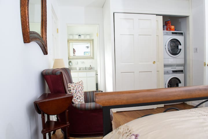 Washer dryer and good closet storage space in bedroom