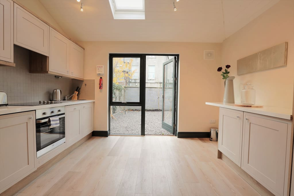 Bright, well appointed kitchen with access to courtyard garden