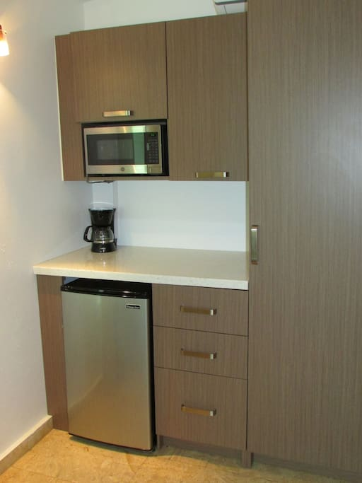 Microwave, small refrigerator and coffee machine in room