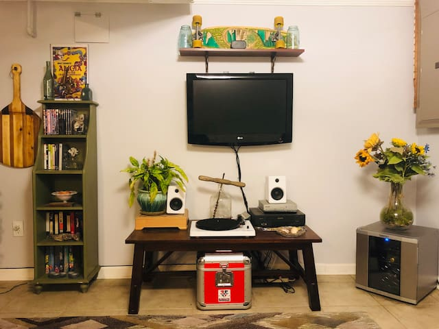 Entertainment center with television, Bluetooth record player