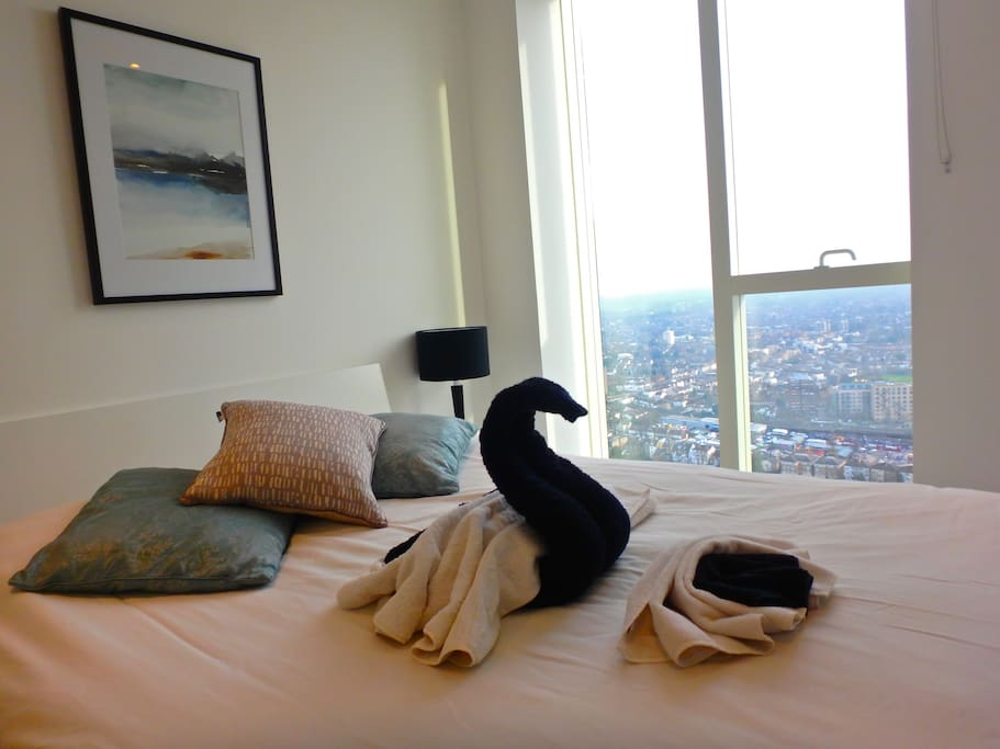 Master bedroom with TV, en-suite and great views across London