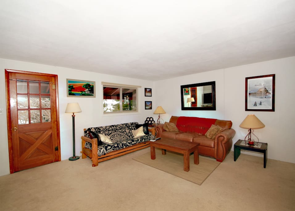 Our large living room that you are welcome to kick back and relax in.