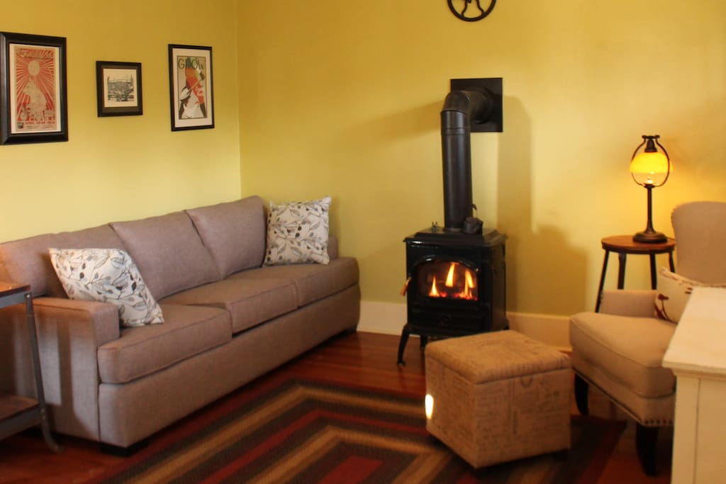 Bright and airy living room, with queen size fold out couch and gas fireplace.