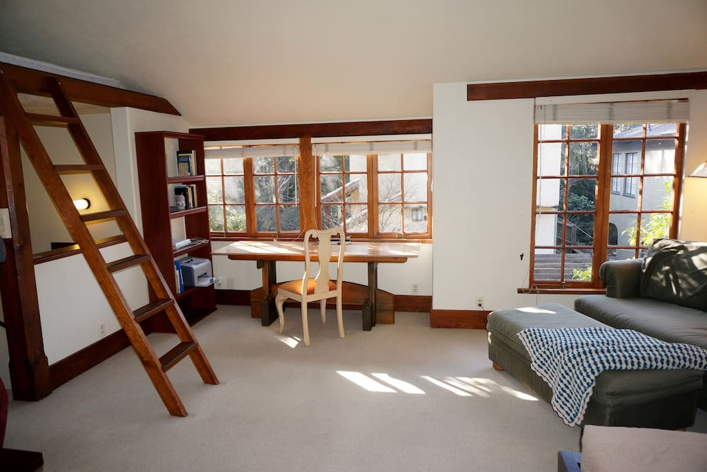 Spacious areas for working, lounging, sleeping.  Sunshine through French windows.