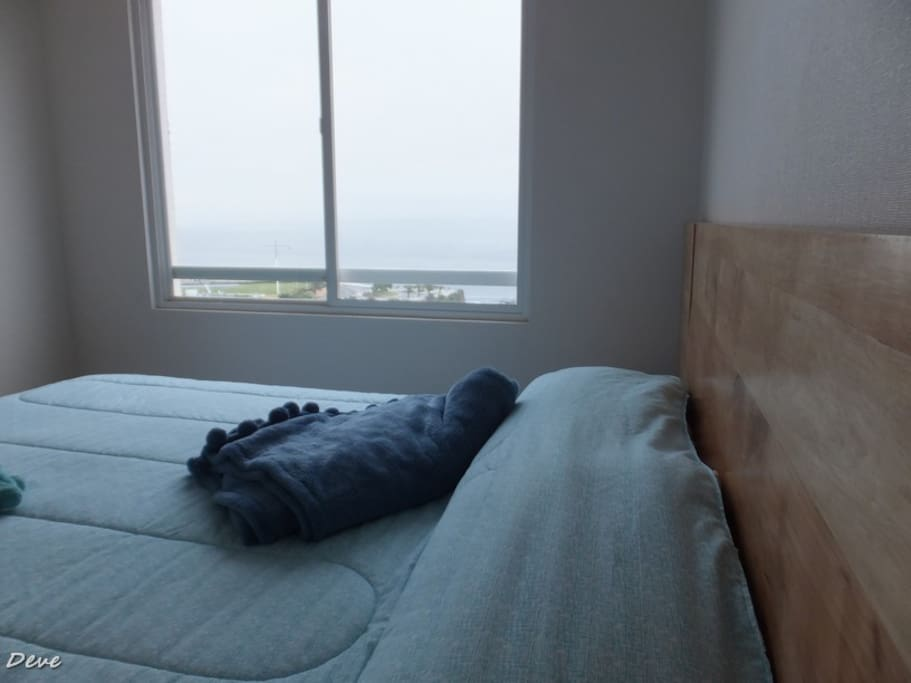 The master bedroom  has a beautiful seaview