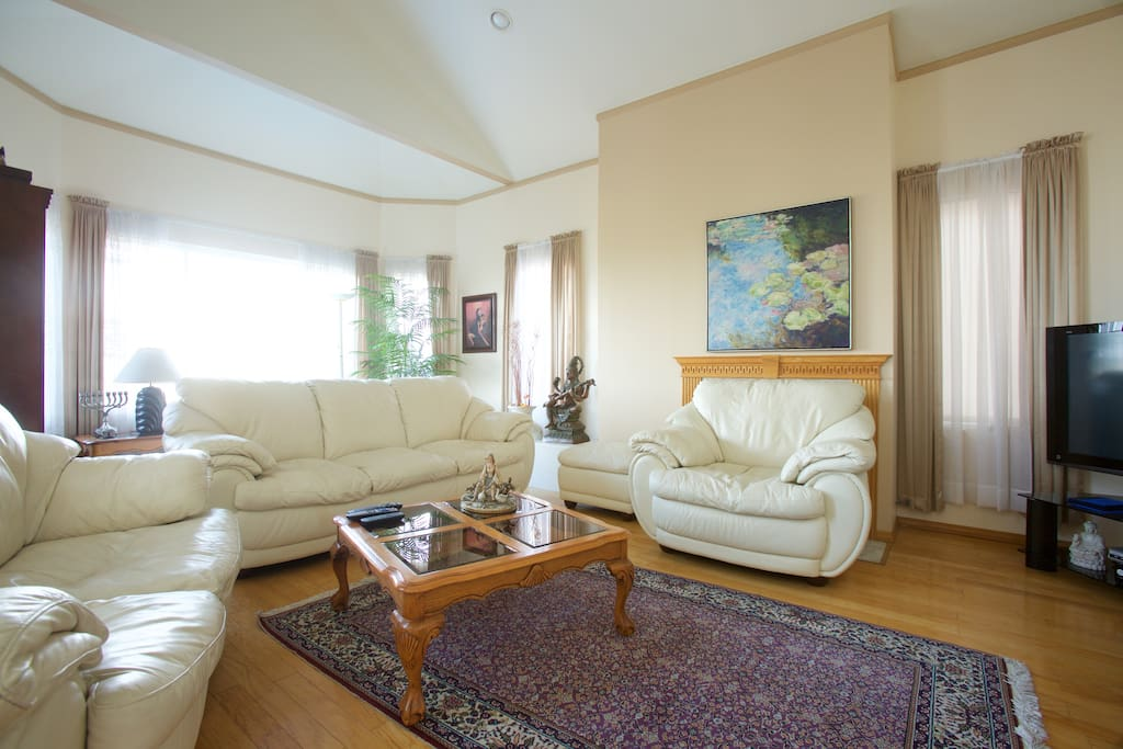 specious living room with cable TV and DVD player