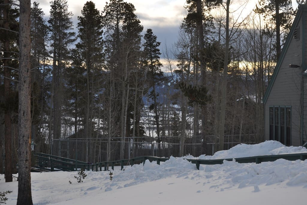 Views from the Treehouse complex. Tennis court in the foreground and Keystone ski slopes in the background