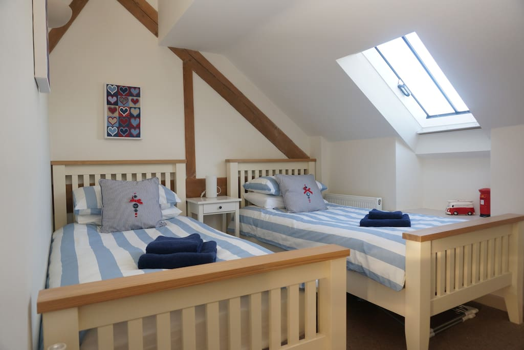 Twin beds in second bedroom