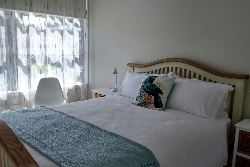 Huia guest room is closer to our apartment It has a duck egg blue throw...cushion has lovely hues.