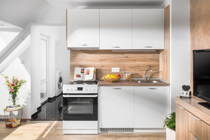 Small and clean kitchen provides the necessary for  a comfort stay