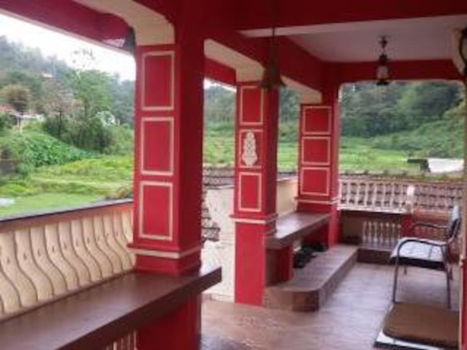 Coorg traditional style sitout/balcony with view.